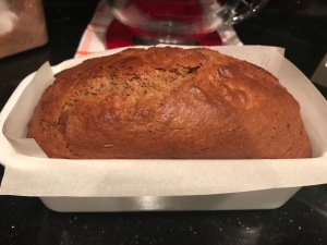 Loaf pan lined with parchment paper